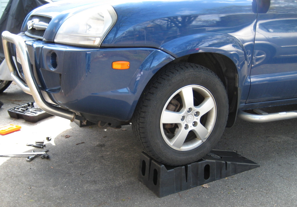 Elevate the front of your Tucson with a jack and jackstands or RhinoRamps.  Remember to chock your rear wheels.